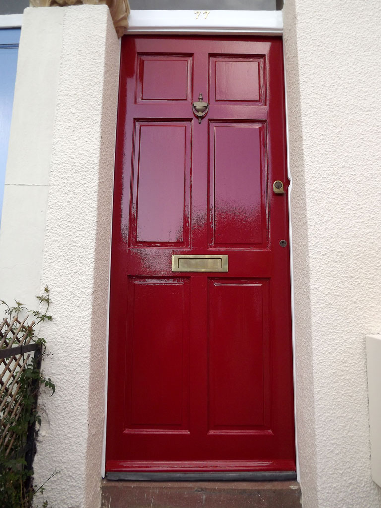 Front door stripped, repaired and painted